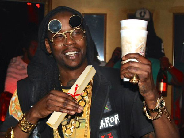 2 Chainz holding his mock degree and some grape drank.